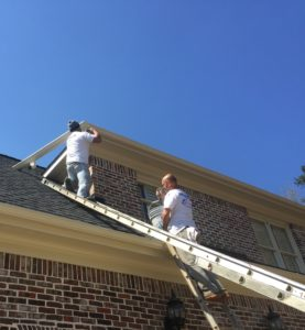 Professional Exterior Painters on Roof of House