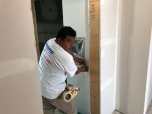 interior commercial painter prepping walls