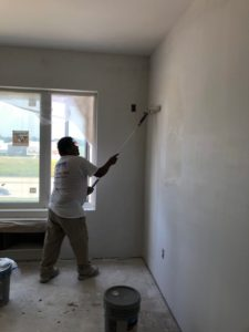 commercial wall painter in action